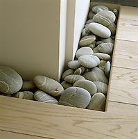 In this living room a Japanese influence may be seen in the incorporation of natural objects into the design such as this collection of simple pebbles
