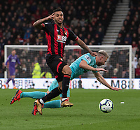 Bournemouth's Joshua King's tackle brings down Newcastle United's Paul Dummett (right) <br /> <br /> Photographer David Horton/CameraSport<br /> <br /> The Premier League - Bournemouth v Newcastle United - Saturday 16th March 2019 - Vitality Stadium - Bournemouth<br /> <br /> World Copyright © 2019 CameraSport. All rights reserved. 43 Linden Ave. Countesthorpe. Leicester. England. LE8 5PG - Tel: +44 (0) 116 277 4147 - admin@camerasport.com - www.camerasport.com