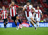 (8) Gonzalo Melero, (8) Ander Iturraspe during the Spanish La Liga soccer match between Athletic Club Bilbao and S.D Huesca at San Mames stadium, in Bilbao, northern Spain, Monday, August, 27, 2018 (Photo: Ion Alcoba Beitia)