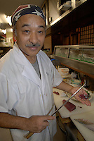 Sakai Shouji, a sushi chef working just a few doors down from the knife shop cuts sashimi using one of their knives. Sakai uses around 10 types of knife plus a special customized set only for cutting sashimi. The most expensive costs around $2000.