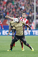 Atletico de Madrid´s Koke (B) and Milan´s Michael Essien during 16th Champions League soccer match at Vicente Calderon stadium in Madrid, Spain. March 11, 2014. (ALTERPHOTOS/Victor Blanco)