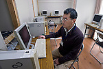 Norio Sato of Smart Technology Partners poses for a photo at  a computer education room set up inside a refugee shelter in Aizu-misato town, Fukushima Prefecture, Japan on 20 April 2013.  Photographer: Rob Gilhooly