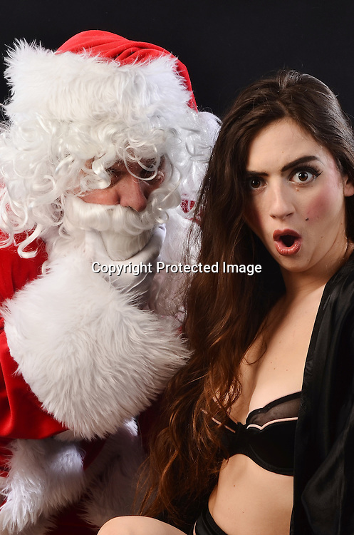 Stock photo of Santa Claus and Sexy Woman