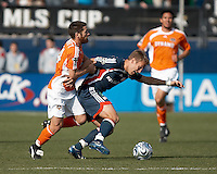 Houston Dynamo defender Wade Barrett (left) gets physical with New England Revolution forward Taylor Twellman (right).  The Houston Dynamo win MLS Cup 2006 over the New England Revolution after playing to a 1-1 tie during regulation and extra time at Pizza Hut Park in Frisco, TX on November 12, 2006.