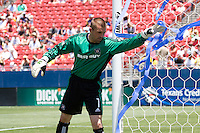 Chicago Fire goalie Jon Busch (1) clears out the streamers thrown on the field by FC Dallas supporters.  Chicago Fire vs FC Dallas at Pizza Hut Park Frisco, Texas June-15-2008.  FC Dallas 1, Chicago 0.