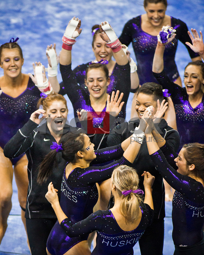 Hatsune Akaogi, Amanda Cline, Kylie Sharp, team celebration..Washington Huskies gymnastics vs. the UCLA Bruins at Alaska Airlines Arena at Hec Edmundson Pavilion in Seattle on Friday, January 27, 2012. (Photo by Dan DeLong/Red Box Pictures)