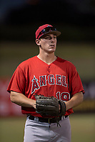 Kiki Menendez (19), of the AZL Angels, warms up the left fielder between innings of an Arizona League game against the AZL Athletics at Tempe Diablo Stadium on June 26, 2018 in Tempe, Arizona. The AZL Athletics defeated the AZL Angels 7-1. (Zachary Lucy/Four Seam Images)