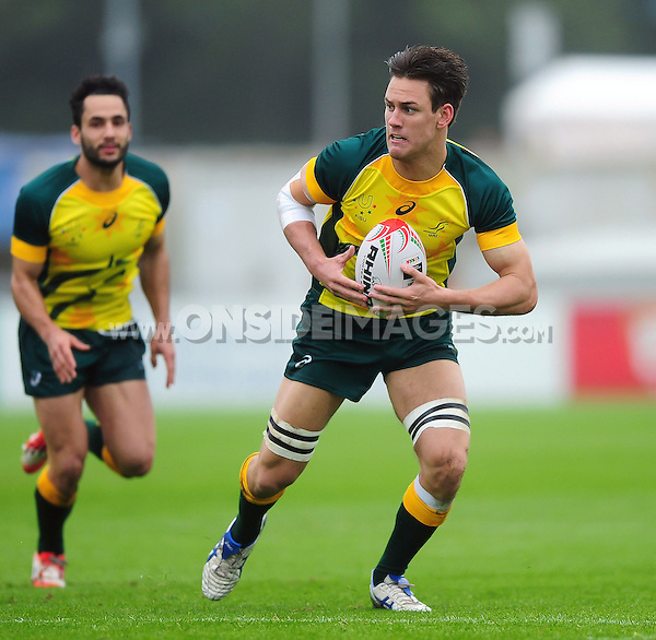 Lachlan Anderson of Australia in possession. FISU World University Championship Rugby Sevens Men's Semi Final between Australia and Spain on July 9, 2016 at the Swansea University International Sports Village in Swansea, Wales. Photo by: Patrick Khachfe / Onside Images
