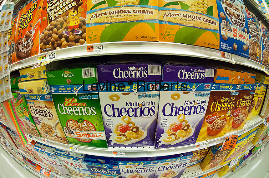 Boxes of General Mills Cheerios breakfast cereals in the grocery department of a store in New York on Tuesday, September 18, 2012.  (© Richard B. Levine)