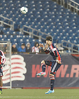 New England Revolution defender Stephen McCarthy (15) clears the ball.  In a Major League Soccer (MLS) match, the New England Revolution (blue) defeated Toronto FC (red), 2-0, at Gillette Stadium on May 25, 2013.
