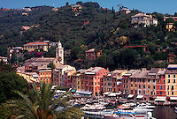 Portofino, Italy. Seaport, homes on hillside, buildings on waterfront