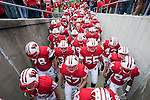 The Wisconsin Badgers run up the tunnel after warmups prior to an NCAA college football game against the Austin Peay Governors on September 25, 2010 at Camp Randall Stadium in Madison, Wisconsin. The Badgers beat the Governors 70-3. (Photo by David Stluka)