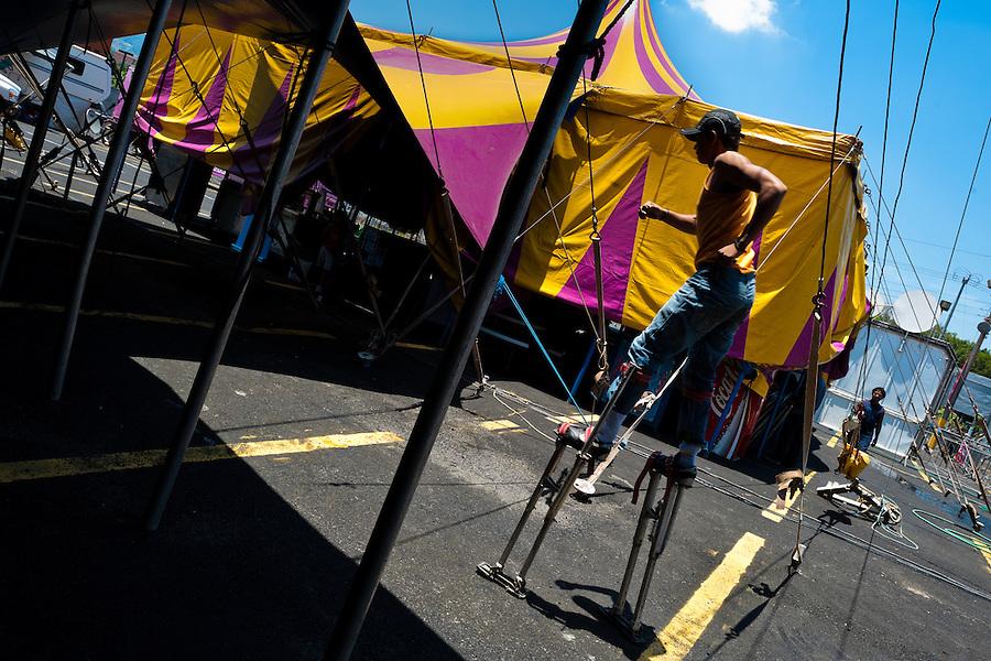 An acrobat trains stilt walking in the backstage of Circus Renato, in San Salvador, El Salvador, 7 May 2011.