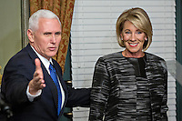 United States Vice President Mike Pence gestures toward attendees after swearing in Betsy DeVos, U.S. Secretary of Education, right, in the Vice President's Ceremonial Office in Washington, D.C., U.S., on Tuesday, Feb. 7, 2017. DeVos squeaked through a history-making Senate confirmation vote to become U.S. education secretary, as Vice President Mike Pence broke a 50-50 tie and Republicans staved off last-minute defections that would have killed her nomination. Photo Credit: Andrew Harrer/CNP/AdMedia