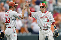 Secondbaseman Cale Ellis #2 of the Oklahoma Sooners celebrates with teammate Garrett Buechele #38 after their win against the Texas Longhorns in NCAA Big XII baseball on May 1, 2011 at Disch Falk Field in Austin, Texas. (Photo by Andrew Woolley / Four Seam Images)