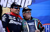 Sept. 14, 2012; Concord, NC, USA: NHRA funny car driver Cruz Pedrgon (left) with John Force during qualifying for the O'Reilly Auto Parts Nationals at zMax Dragway. Mandatory Credit: Mark J. Rebilas-
