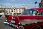HAVANA, CUBA -- MARCH 23, 2015:  A Chevy BelAir drives past the Gran Teatro de La Habana in Havana, Cuba on March 23, 2015. Photograph by Michael Nagle