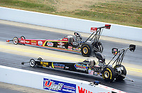 Apr. 14, 2012; Concord, NC, USA: NHRA top alcohol dragster driver Aaron Tatum (near lane) races alongside Doug Foley during qualifying for the Four Wide Nationals at zMax Dragway. Mandatory Credit: Mark J. Rebilas-