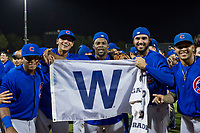 Nelson Velazquez (20), Luis Vazquez (1), Alfredo Colorado (75), Emilio Ferrebus (43), and Eugenio Palma (86) celebrate with the Cubs Win Flag after defeating the AZL Giants on September 7, 2017 at Scottsdale Stadium in Scottsdale, Arizona. AZL Cubs defeated the AZL Giants 13-3 to win the Arizona League Championship Series two games to one. (Zachary Lucy/Four Seam Images)