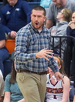Josh Laymon, Rogers Heritage head coach, reacts vs Springdale Har-Ber Friday, Jan. 10, 2020, at War Eagle Arena in Rogers. Go to nwaonline.com/photos to see more photos.<br /> (NWA Democrat-Gazette/Ben Goff)