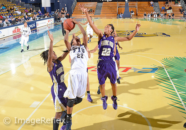 Florida International University guard Jerica Coley (22) plays against Prairie View A&M University. FIU won the game 77-52 on December 6, 2013 at Miami, Florida.