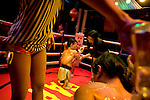 In the Ringside bar, where Alvin fights, the midgets and the ring are oiled up for a bout.<br /> <br /> In the red light area of Manila's Makati district, customers who've had enough of dancing girls have another form of exploitation to amuse them: midget oil wrestling.