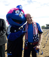 Earthquakes owner Lew Wolff pose together with Earthquakes mascot Q during Groundbreaking Ceremony at new stadium in Santa Clara, California on October 21st, 2012.  San Jose Earthquakes broke Guinness World Record for 6,256 people break ground on Quakes' new stadium.
