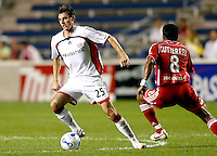 New England Revolution midfielder Andy Dorman (25) tries to dribble away from Chicago Fire midfielder Diego Gutierrez (8).  The Chicago Fire defeated the New England Revolution 2-1 in the quarterfinals of the U.S. Open Cup at Toyota Park in Bridgeview, IL on August 23, 2006...