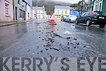 Flood water in Cahersiveen on Saturday burst up through the roads due to pressure, pictured here outside the Community Centre.