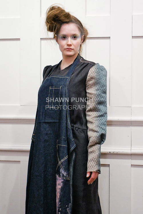 """Model poses in an outfit from the Susan Cianciolo Fall/Winter 2011 """"when buildings meet the sky"""" collection, during New York Fashion Week, February 16, 2011."""