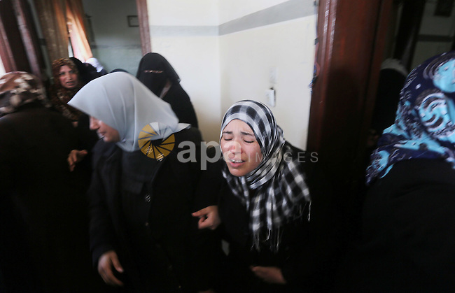 Relatives of Palestinian Hamas militant Ahmed al-Zahar, who was killed when a tunnel collapse on Tuesday, mourn during his funeral in the village of Al-Moghraga near central Gaza Strip, February 3, 2016. The collapse of a tunnel in the Gaza Strip has killed two militants from Hamas's armed wing, officials said Wednesday, as concern grows in Israel over the rebuilding of tunnels that can be used for attacks. Photo by Mohammed Asad
