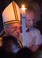 Papa Francesco celebra la veglia di Pasqua nella Basilica di San Pietro, Citta' del Vaticano, 4 aprile 2015.<br /> Pope Francis holds a candle at his arrival to celebrate the Easter vigil in St. Peter's Basilica at the Vatican, 4 April 2015.<br /> UPDATE IMAGES PRESS/Riccardo De Luca<br /> <br /> STRICTLY ONLY FOR EDITORIAL USE