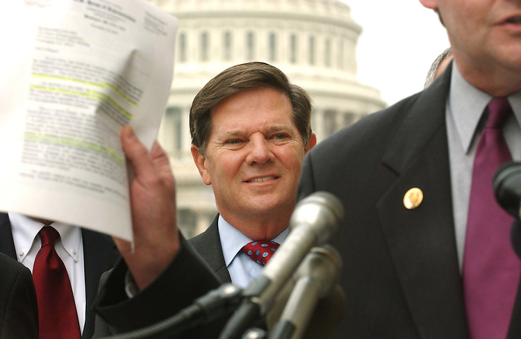 "11/19/04.DELAY/ETHICS--Majority Leader Tom DeLay, R-Texas, looks on as John T. Doolittle, R-Calif., holds up a copy of the letter from the ethics panel to Rep. Chris Bell, D-Texas, during a news conference on the House Committee on Standards of Official Conduct rebuke yesterday of Bell, who initiated an ethics complaint against DeLay. The admonishment of Bell came six weeks after the panel rebuked DeLay for actions related to two of the matters cited in Bell's complaint. The ethics panel found Bell in violation of a rule that an ethics complaint ""shall not contain innuendo, speculative assertions, or conclusory statements."".CONGRESSIONAL QUARTERLY PHOTO BY SCOTT J. FERRELL"