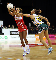 01.11.2012 England's Serenia Guthrie and South Africa's Zanele Mdodana in action during the netball test match between England and South Africa as part of the Quad Series played at the Claudelands Arena in Hamilton. Mandatory Photo Credit ©Michael Bradley.