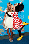 Ashley Tisdale gets a kiss from Mickey Mouse.14 August 2007.Photo by Nina Prommer/Milestone Photo