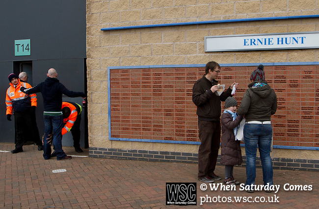 Coventry City 1 Birmingham City 1, 10/03/2012. Ricoh Arena, Championship. Home fans standing in front of a 'Wall of Fame' dedicated to former home playerErnie Hunt outside the Ricoh Arena, pictured before Coventry City hosted Birmingham City in an Npower Championship fixture. The match ended in a one-all draw, watched by a crowd of 22,240. The Championship was the division below the top level of English football. Photo by Colin McPherson.