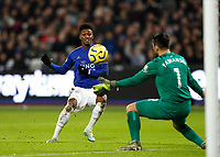 28th December 2019; London Stadium, London, England; English Premier League Football, West Ham United versus Leicester City; Demarai Gray of Leicester City shoots to score his sides 2nd goal in the 56th minute to make it 2-1 past Goalkeeper Lukasz Fabianski of West Ham United - Strictly Editorial Use Only. No use with unauthorized audio, video, data, fixture lists, club/league logos or 'live' services. Online in-match use limited to 120 images, no video emulation. No use in betting, games or single club/league/player publications