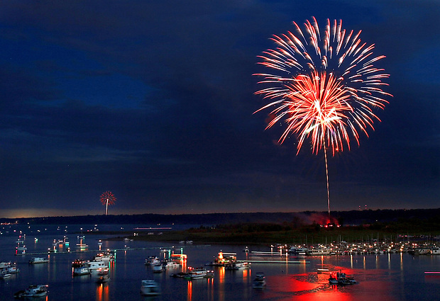 Fireworks near and far can be seen overlooking the Saylorville Lake marina Monday, July 3, 2006.