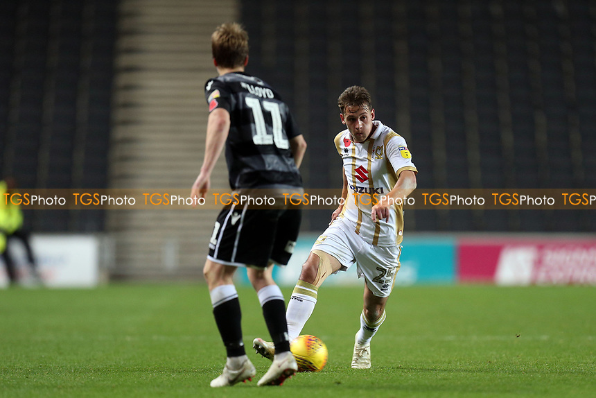 Callum Brittain of MK Dons and Ryan Lloyd of Macclesfield Town during MK Dons vs Macclesfield Town, Sky Bet EFL League 2 Football at stadium:mk on 17th November 2018