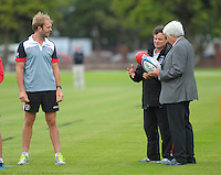 Wellington City Councillor John Morrison (right) compares balls with St Kilda AFL coach Scott Watters as Beau Wilkes (left) looks on during the Hurricanes Super 15 rugby training at Hutt Recreation Ground, Lower Hutt, Wellington, New Zealand on Thursday, 24 January 2013. Photo: Dave Lintott / lintottphoto.co.nz