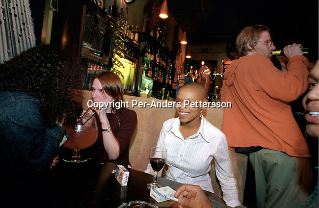 CAPE TOWN, SOUTH AFRICA - OCTOBER 23 : People partying in the bar at Jo'burg, a popular nightspot on October 23, 2003 on long street in Cape Town, South Africa. The club is one of the most popular in Cape Town..(Photo: Per-Anders Pettersson/Getty Images)