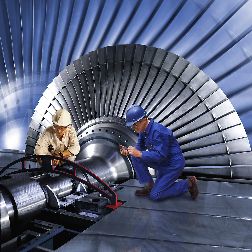 Hong Kong, China.  Engineers align turbine rotor shaft during construction of power station steam turbine.