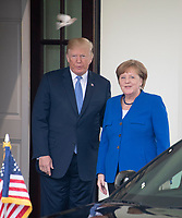 A bird flies over the head of United States President Donald J. Trump as he welcomes Chancellor Angela Merkel of Germany to the White House in Washington, DC for talks on Friday, April 27, 2018.<br /> Credit: Ron Sachs / CNP /MediaPunch