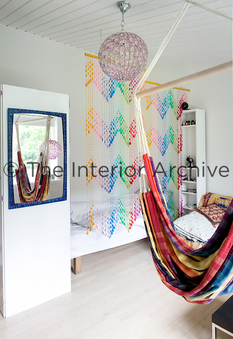 This teenage bedroom has been designed on a budget, resulting in many creative and colourful decorative solutions