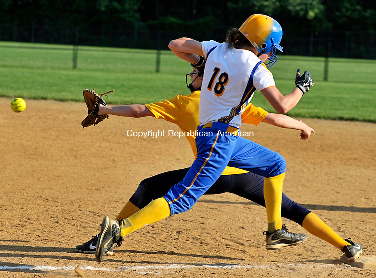 SEYMOUR, CT - 31 May 2013-053113EC04--    Seymour's Katie Petroski tries to outrun the ball to East Haven's first baseman Amanda Jessey Friday. Petroski was called out. East Haven beat the Wildcats in Seymour, 1-0, in 8 innings. Erin Covey Republican-American.