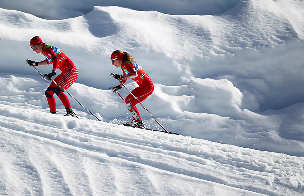 USA's Caitlin Compton trails another competitor while climbibg a hill in the team sprint freestyle final at the XXI Olympic Winter Games Monday, February 22, 2010 at Whistler Olympic Park in Whistler, British Columbia.