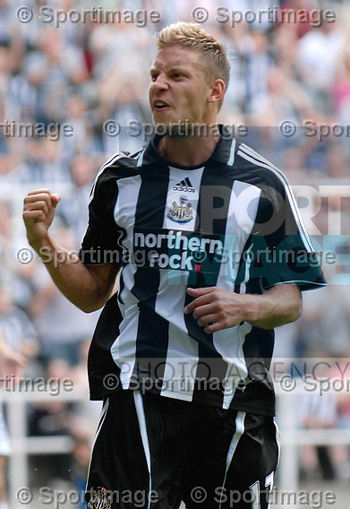 Newcastle's Alan Smith shows his delight in scoring his first goal.
