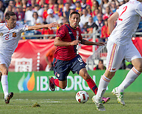USA midfielder Clint Dempsey (8) dribbles as Spain midfielder Bruno Soriano (8) closes. In a friendly match, Spain defeated USA, 4-0, at Gillette Stadium on June 4, 2011.