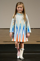 Model walks runway in an outfit by Carlucci Kids, during the petitePARADE Children's Club fashion show at the Jacob Javits Center in New York City, on January 9, 2016.