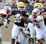 SIOUX FALLS, SD - SEPTEMBER 7:  CJ Ham #28 from Augustana is dragged down by Aaron Bohl #44 and Garrett Shelley #18 from Minnesota State University Moorhead in the first quarter of their game Saturday at Augustana. (Photo by Dave Eggen/Inertia)